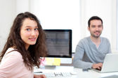 Young attractive co-worker at the office — Stock Photo