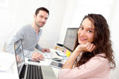 Young attractive co-workers at the office — Stock Photo