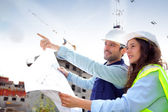 Co-workers on a construction site — Stock Photo