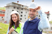 Portrait of co-workers on a construction site — Stock Photo