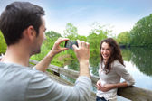 Man taking pictures of his girlfriend — Stock Photo