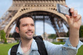 Young attractive tourist taking selfie in Paris — Stock Photo