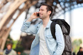 Young attractive tourist phoning in Paris — Stock Photo