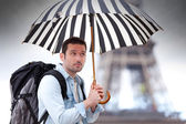 Young attractive man suffering rain in Paris — Stock Photo