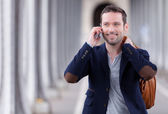 Young attractive man using smartphone in Paris — Stock Photo