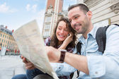 Young couple of tourists booking an activity — Stock Photo