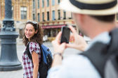 Man taking picture of his girlfriend on hoildays — Stock Photo