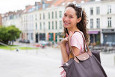 Woman going to shopping in the city — Stock Photo