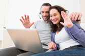Young happy couple video calling on computer — Stock Photo