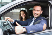Young business man couple in their brand new car  — Stock Photo