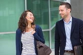 Business man and woman chatting together after work — Stock Photo