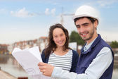 Architect woman and construction site supervisor — Stock Photo