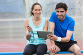 Sport coach training a young attractive woman — Stock Photo