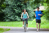 Young sportive couple jogging at the park — Stock Photo