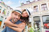 Young happy couple having fun on holidays — Stock Photo