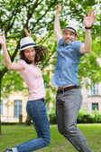 Young happy couple having fun at the park — Stock Photo