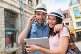Young couple of tourists booking hostel — Stock Photo