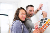 Young couple choosing colors of their new flat — Stock Photo