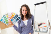 Young woman choosing colors of their new flat — Stock Photo
