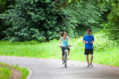 Young sportive couple jogging at the park — Stok fotoğraf