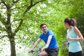 Young sportive couple jogging at the park — Foto Stock