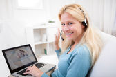Young attractive woman blonde chatting on laptop — Stock Photo