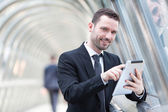 Portrait of an attractive businessman using a tablet — Stock Photo