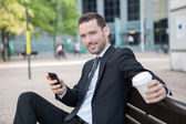 Businessman drinking a coffee during a break — Stock Photo
