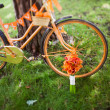Wedding bouquet and orange bike — Stock Photo #40956105