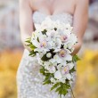 White wedding bouquet in the hands of the bride — Stock Photo #40956283