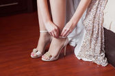Bride dresses wedding shoes — Stock Photo