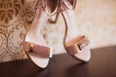 Gold bridal shoes — Stock Photo