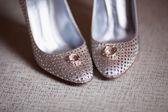 Wedding rings, bridal shoes — Stock Photo