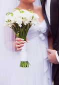 Bridal bouquet in the hands of the bride — Stock Photo