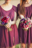 Bridesmaids  with a wedding bouquet — Stock Photo