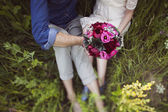 Wedding bouquet in the hands of the bride — Stock Photo