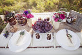 Wedding table with wine and grapes — Stock Photo