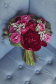 Wedding bouquet of red and pink roses and peonies — Stock Photo