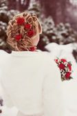 Bride hairstyle with red roses — Stock Photo