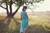 Brunette woman in a field — Stock Photo