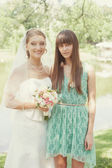 Bride and witness near the lake — Stock Photo