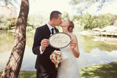 "Bride and groom with a sign ""Just married"" — Stock Photo"