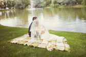 Bride and groom  near the lake — Stock Photo