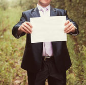 Groom  with blank of paper — Stock Photo