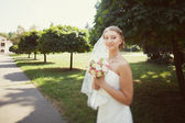 Bride walking in the park — Stock Photo