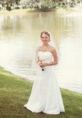 Bride near the lake — Stock Photo