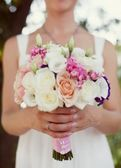 Bride holding  weeding bouquet — Foto Stock