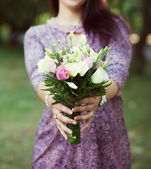 Bride in a blue dress with a bouquet — Stock Photo