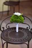 Wedding bouquet on a chair — Foto Stock
