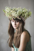 Beautiful brunette girl with a wreath in her hair — Stock Photo